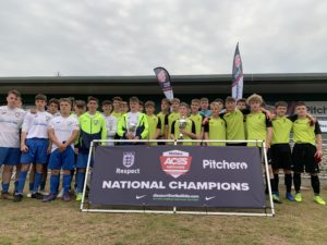 Cirencester Town celebrate their Pitchero Aces Nationals victory with a group photo with the National Champions banner